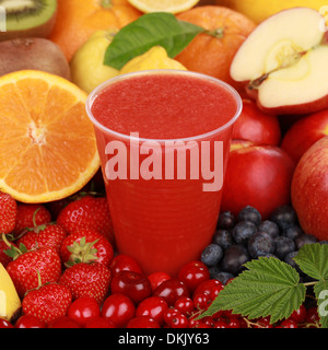 Freshly squeezed juice from red fruits such as oranges, cherries, berries and strawberries - Stock Photo