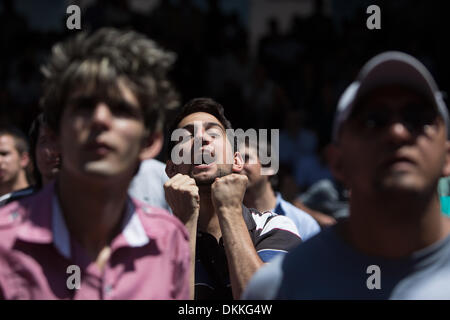 Buenos Aires, Argentina. 6th Dec, 2013.  People react as they wait for the final draw for the groups and matchups - Stock Photo