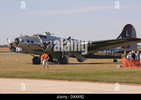 Boeng B1-17G Flying Fortress prepares to tke off for the air show in Bellville, Michigan while many look on - Stock Photo