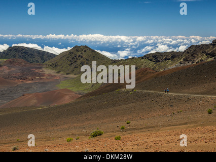 Two hikers walk along the descent into the Haleakala crater in Maui - Stock Photo