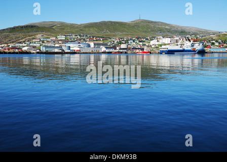 Blue water of the fjord against the northernmost city Hammerfest - Stock Photo