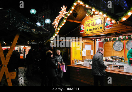 Stand with food on the christmas market - Stock Photo