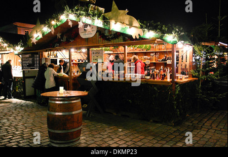 Stand with liquors on christmas market - Stock Photo