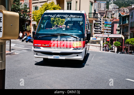 Red tourist bus on the streets of Monaco, sovereign city-state, French Riviera, Western Europe - Stock Photo