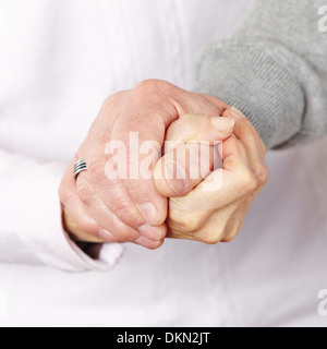 Happy senior citizen couple holding their hands together - Stock Photo