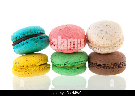Colorful stacked French macaroons isolated over white background - Stock Photo