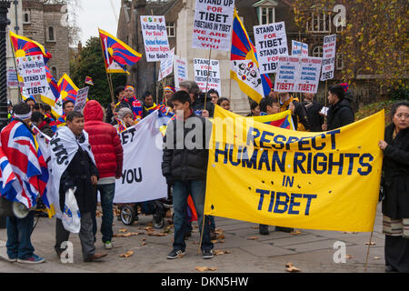 London, UK. 7th Dec 2013.  Tibetans gather opposite Parliament in protest against human rights abuses and the ongoing - Stock Photo
