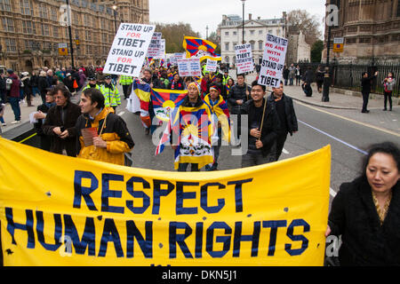 London, UK. 7th Dec 2013.  Tibetans march in protest against human rights abuses and the ongoing occupation of Tibet - Stock Photo