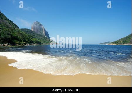 Classic view of Sugarloaf Mountain Pao de Acucar Rio de Janeiro Brazil from Praia Vermelha Red Beach - Stock Photo