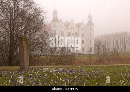 Castle of Ahrensburg with fog - Stock Photo