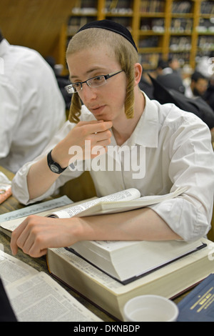 Lubavitch Hasidic student with peyot studying at their headquarters and synagogue at 770 Eastern Parkway in Brooklyn, - Stock Photo