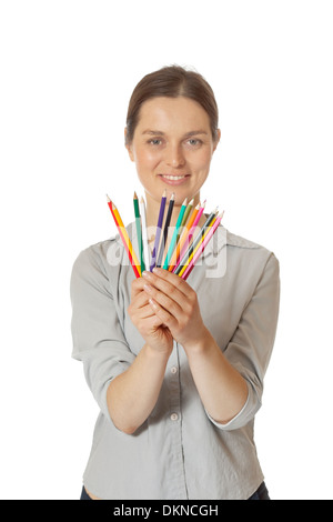 Woman choosing coloured pencil - Stock Photo