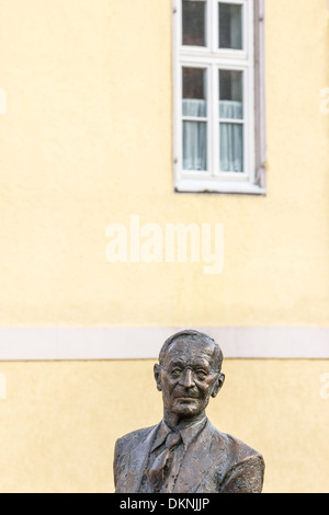 sculpture by kurt tassotti showing writer hermann hesse on the nikolaus bridge in his native town of calw, black - Stock Photo