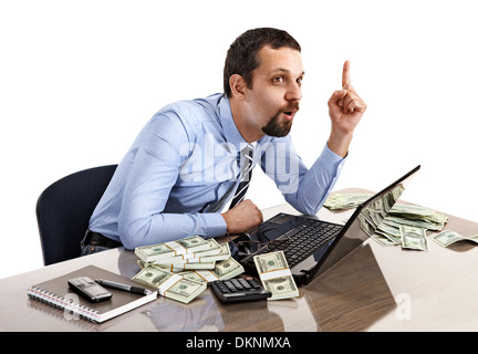 Portrait of a young businessman have an idea while working with laptop - Stock Photo