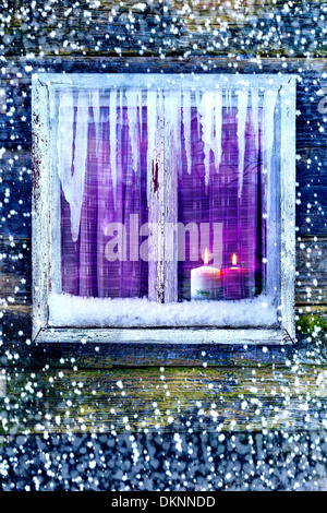 Lit candles in the window. Time Christmas and New Year - Stock Photo