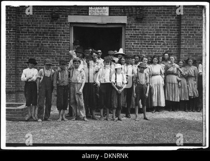 Part of the force at Tupelo Cotton Mills. All work. Smallest ones not in photo. Among youngest here are, Coleman... - Stock Photo