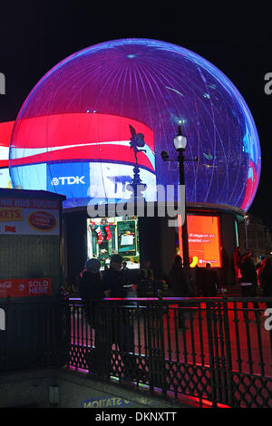 London, UK. 8th December 2013. Statue of Eros encased in a Snow Globe, Piccadilly Circus, London, England Credit: - Stock Photo