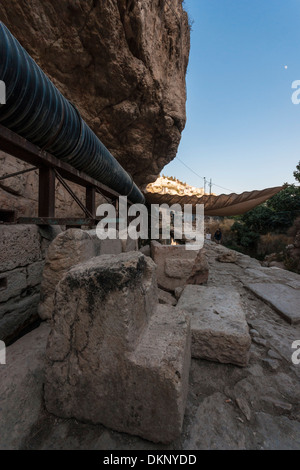 Israel. The remains of the Shiloah pool, used to supply water to Jerusalem at ancient times.Silwan Village in far - Stock Photo