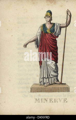 Minerva, Roman goddess of wisdom, with helmet, breastplate and staff. - Stock Photo