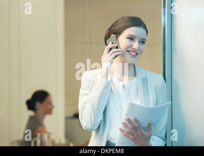 Businesswoman talking on cell phone - Stock Photo