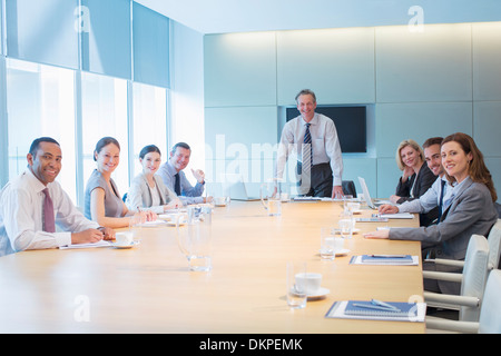Business people smiling in meeting - Stock Photo