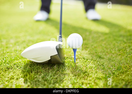 Man playing golf on course - Stock Photo
