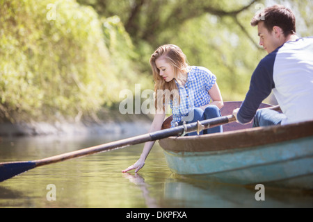 Couple in rowboat on river - Stock Photo