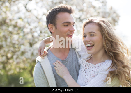 Couple hugging outdoors - Stock Photo