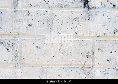 Close up on a wall made from bricks. Isolated on white.  - Stock Photo