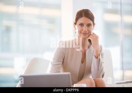 Businesswoman working at laptop - Stock Photo
