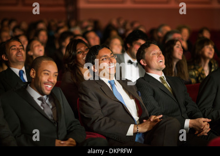 Laughing theater audience - Stock Photo