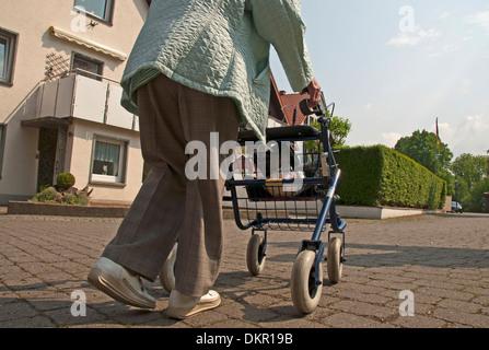 old Germany Europe woman walking car person model release pensioner person retiree wheeled walker Salzkotten boss - Stock Photo