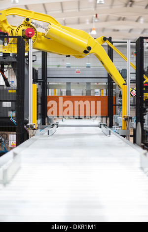 Robotic machinery in factory - Stock Photo