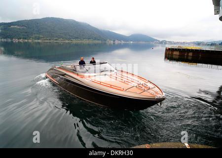 A Rivarama super yacht near the Riva factory on a misty Lake Iseo in Sarnico, Italy. - Stock Photo
