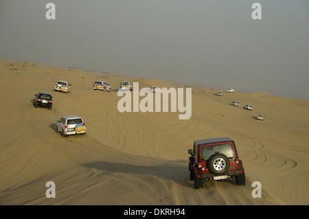 Desert Safari on jeep. Dune bashing in dubai - Stock Photo