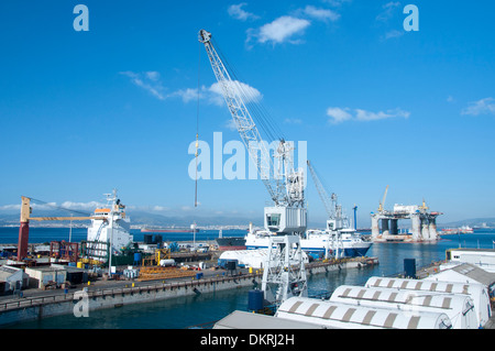The dockyard in Gibraltar with various vessels in the frame. - Stock Photo