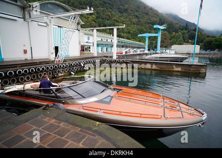 A Rivarama super yacht outside the Riva factory on a misty Lake Iseo in Sarnico, Italy. - Stock Photo