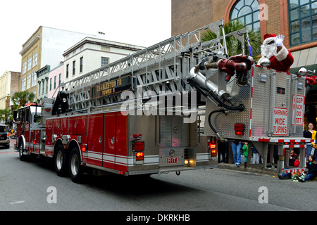 Santa Claus on fire engine - Stock Photo