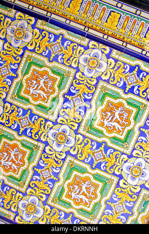 Close up of traditional Spanish ornate ceramic wall tiles. Multi coloured with yellows, blues & oranges, Malaga, - Stock Photo