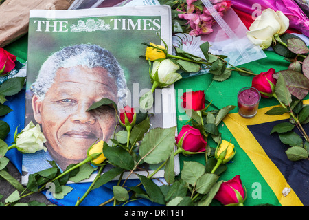 RIP President Nelson Mandela - Photograph of Madiba in the Times newspaper and roses at a shrine for an iconic leader - Stock Photo