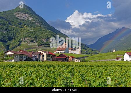 Europe Switzerland CH Vaud Aigle Chemin du Golliez castle Aigle castle place wine vineyards rainbows architecture - Stock Photo