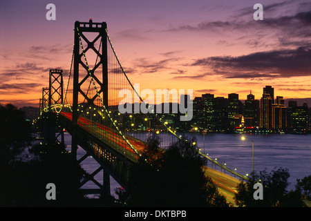Sunset over the Oakland - San Francisco Bay Bridge and downtown San Francisco, California - Stock Photo