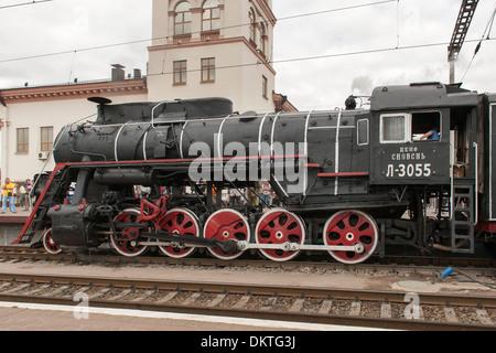 Old steam locomotive in the central station in Kiev, the capital of Ukraine. - Stock Photo