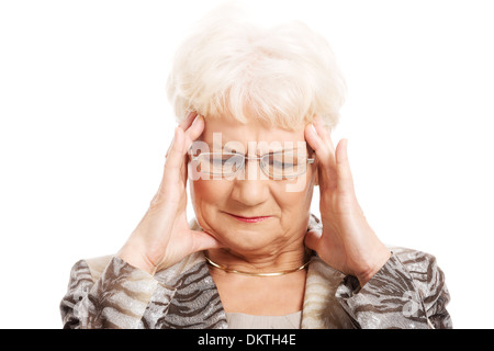 An old elegant lady is having a headache. Isolated on white.  - Stock Photo