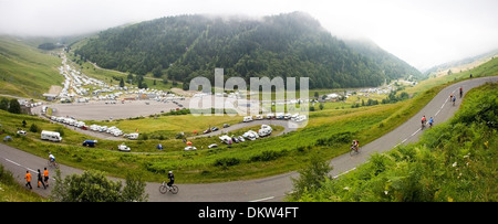 Camper vans on the lower slopes of the Col du Tourmalet await the arrival of the Tour de France - Stock Photo