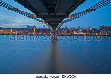 The underside of Millennium Bridge as seen from Bankside , south London. The bridge spans the river Thames near - Stock Photo