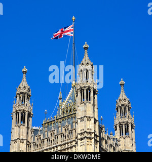 Union flag flying from the top of the Victoria Tower at the Houses of Parliament - Stock Photo