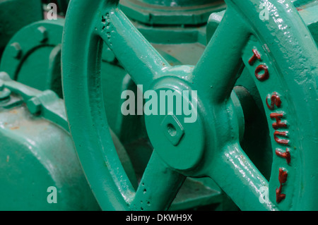 A large cast-iron cut-off wheel on a valve - Stock Photo