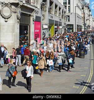 Crowd of people including shoppers in London West End Oxford Street pavement outside Topshop store with sale on - Stock Photo