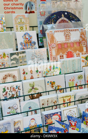 Christmas cards on sale at a market stall - Stock Photo